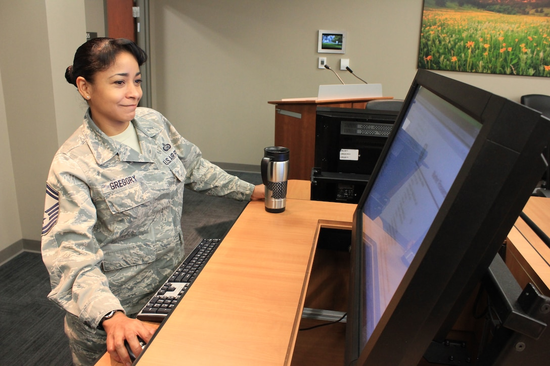 Senior Master Sgt. Bernadette Gregory, superintendent, Reserve of the Air Force Selection Board Secretariat, sets up a terminal for use in the promotion board room at Air Reserve Personnel Center, Buckley Air Force Base. The secretariat facilitates officer promotion boards for the U.S. Air Force. (U.S. Air Force photo/Master Sgt. Christian Michael)