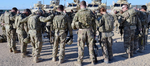 Soldiers with Task Force Centurion Prime's HHC and C Company pray together before heading out on a mission recently in Jalalabad, Afghanistan. (Courtesy photo)