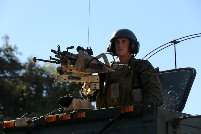 MARINE CORPS BASE CAMP PENDLETON, Calif., -- Sergeant Jeremy Coningford, launcher chief, Tango Battery, 5th Battalion, 11th Marine Regiment, mans an M249 Squad Automatic Weapon mounted on a High Mobility Artillery Rocket System during a training exercise at the Mobile Immersion Trainer here, Nov. 14, 2013. The MIT is similar to the Infantry Immersion Trainer and trains Marines to operate under stressful conditions. Throughout the morning, the battery simulated operating out of a base and posted security while mock insurgents attempted to breach the area and formed riots. The artillerymen later conducted a logistics patrol and recovered a broken vehicle, countered an improvised explosive device and repelled enemy role-players during an ambush.