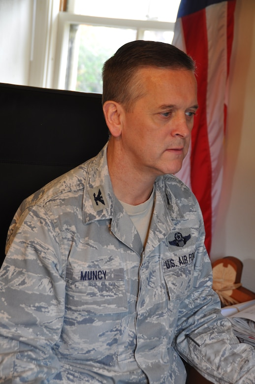 Col. Russell Muncy answers e-mails from his new office in the Hap Arnold House at March Air Reserve Base, Calif., Nov. 15, 2013. Muncy was gained as the commander of the 452nd Air Mobility Wing on Nov. 3 and will assume command at a ceremony Nov. 23. (U.S. Air Force photo/Linda Welz)