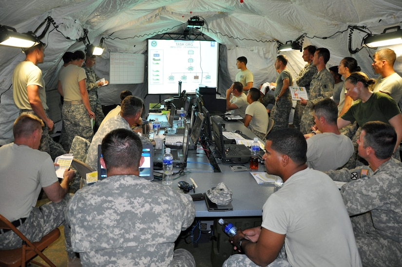 Members of the 1-228th Aviation Regiment work in the Tactical Operations Center (TOC) in Mocoron, Honduras during a week-long Collective Training Exercise (CTE) conducted by the unit, Nov. 19, 2013.  During the exercise, the members of the 1-228th operated from a field environment and responded to both exercise and real-world mission requirements.  (U.S. Air Force photo by Capt. Zach Anderson)