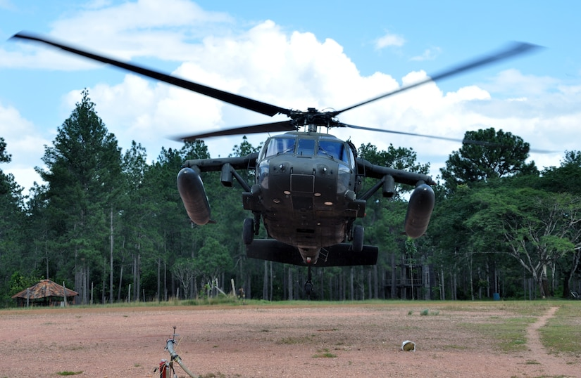 A UH-60 Blackhawk helicopter assigned to the 1-228th Aviation Regiment lifts off from Mocoron, Honduras, Nov. 19, 2013.  The helicopter was responding to a training scenario as part of a week-long Collective Training Exercise (CTE) being condcuted by the 1-228th.  (U.S. Air Force photo by Capt. Zach Anderson)