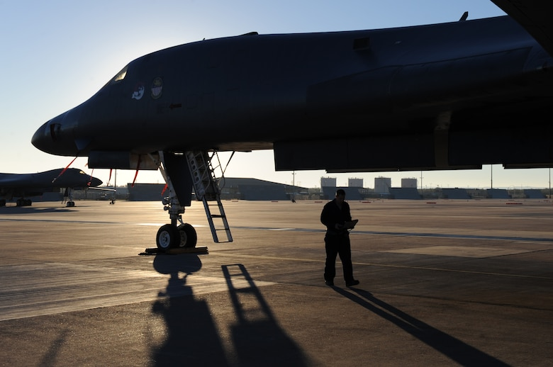 U.S. Air Force Staff Sgt. Ryan Blanton, 7th Aircraft Maintenance Squadron, finishes an inspection of a B-1 bomber Nov. 17, 2013 at Dyess Air Force Base, Texas. Blanton uses a laptop and safety manual to begin maintenance on the plane for the day. Very specific safety protocols must be followed in order to safely work on the multi-million dollar aircraft. (U.S. Air Force photo by Airman 1st Class Alexander Guerrero/Released)