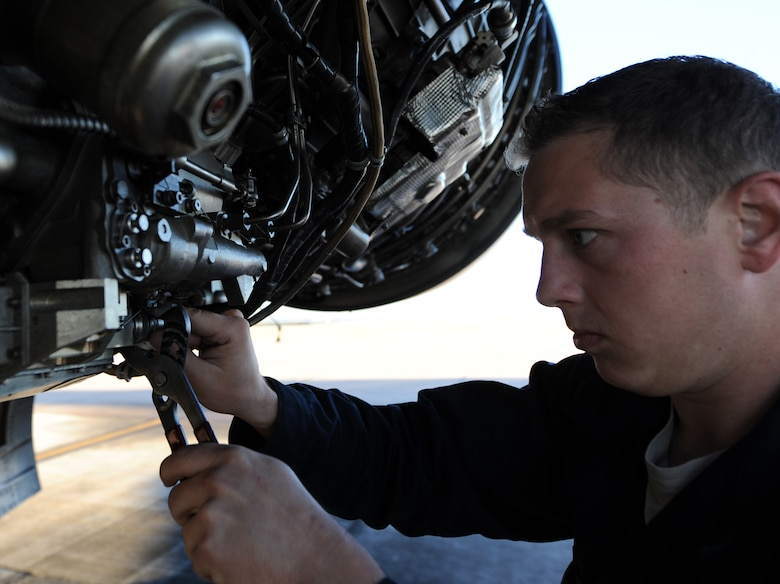 U.S. Air Force Staff Sgt. Ryan Blanton, 7th Aircraft Maintenance Squadron, checks the connection to a fuel system component Nov. 17, 2013, at Dyess Air Force Base, Texas. Blanton has extensive training on B-1 engine maintenance and is qualified to completely remove, disassemble and reassemble the jet engines. (U.S. Air Force photo by Airman 1st Class Alexander Guerrero/Released)