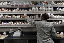 Senior Airman Lesley Perry, pharmacy technician, fills prescriptions at Maxwell Air Force Base, Nov. 6. During the medical group's recent inspection, the pharmacy was instrumental in the group receiving a rating of excellent, with the pharmacy earning a perfect score with no findings. (U.S. Air Force photo by Staff Sgt. Natasha Stannard)