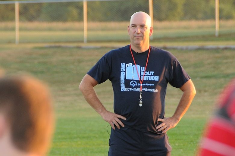 Adorned with an official coach's whistle, Air National Guard Master Sgt. Bill Wiseman coaches flag football in South Sioux City, Nebraska. Wiseman, who has been working with South Sioux City Special Olympics for many years, was recently awarded the Military Outstanding Volunteer Service Medal for his involvement in Special Olympics. Wiseman is a member of the Iowa Air Guard's 185th Air Refueling Wing, in Sioux City, Iowa. U.S. Air National Guard Photo by: Master Sgt. Vincent De Groot 185ARW Wing PA