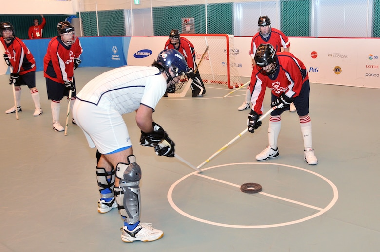 Members of the Special Olympics Team USA Unified Floor Hockey team face off against Team Hong Kong in a preliminary round game at the Special Olympics Winter World Games that were held in Pyeongchang, South Korea in February 2013. The US unified team, from South Sioux City, NE, played four different teams from three continents before defeating Sweden 4-3 in four overtimes to go 7-0 in the tournament and winning gold medals.  US Air National Guard photo by Master Sgt. Bill Wiseman (Released)