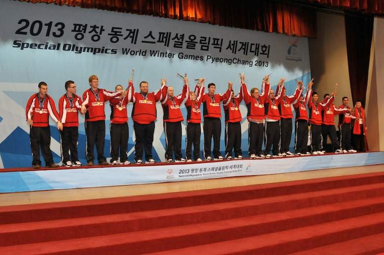 Members of the Special Olympics Team USA Unified Floor Hockey team receive their gold medals at the Special Olympics Winter World Games that were held in Pyeongchang, South Korea in February 2013.  The US team, from South Sioux City, NE, defeated Sweden 4-3 in four overtimes in the championship game to go 7-0 in the tournament and earn their gold medals.  US Air National Guard photo by Master Sgt. Bill Wiseman (Released)