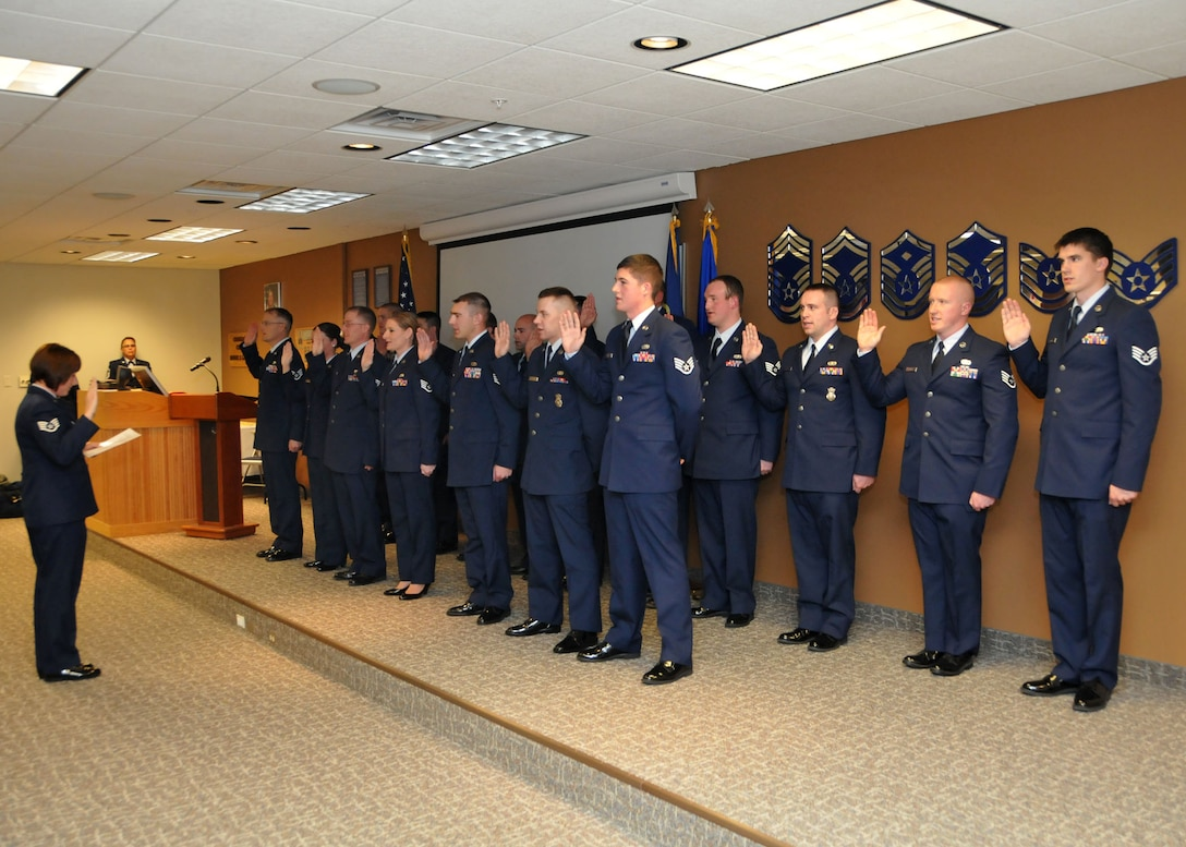 Newly-promoted NCOs are assembled on stage during the Montana Air National Guard NCO Induction Ceremony held at the 120th Fighter Wing in Great Falls, Mont. on Nov. 4, 2013. National Guard photo/Senior Airman Nik Asmussen.