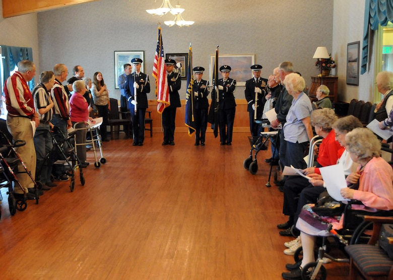Members of the Montana Air National Guard Honor Guard present the colors for the residents of The Lodge Retirement and Care Center during their annual Veterans Day ceremony in Great Falls, Mont. on Nov. 11, 2013.  National Guard photo/Senior Master Sgt. Eric Peterson.