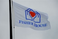 The Fisher House Foundation flag waves outside the Fisher House for Families of the Fallen at Dover Air Force Base, Del. The Fisher House is the first of its kind. It was gifted to the Air Force from the foundation for families travelling to Dover to witness a dignified transfer. (U.S. Air Force photo)