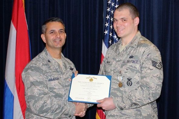 U.S. Air Force Col. David J. Julazadeh, 52nd Fighter Wing commander, presents Staff Sgt. Nathan P. Londak, a security forces Airman stationed at Volkel Air Base, The Netherlands, an Airman's Medal on Nov. 15. This medal is given to service members who distinguish themselves with heroic actions, usually at the voluntary risk of their lives, but without involving combat. Londak received this medal for his heroic actions in stopping an armed robbery in March 2011. (U.S. Air Force courtesy photo/released)