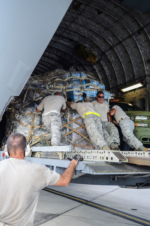 Airmen from the the 36th Contingency Response Group and 734th Air Mobility Squadron move pallets in a C-17 Globemaster III Nov. 15, 2013, on the Andersen Air Force Base, Guam, flightline before the aircraft departs to support Operation Damayan in Tacloban, Philippines. Operation Damayan is a U.S. humanitarian aid and disaster relief effort to support the Philippines in the wake of the devastating effects of Typhoon Haiyan.