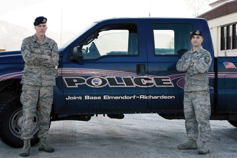 (Left to right) Master sergeants David Barber and Morgan Cabaniss, 673 Security Forces Squadron, pose for the camera on Joint Base Elmendorf-Richardson, Alaska, Nov. 18, 2013. Barber and Cabaniss rescued a wrecked trucker 100 miles north of Arctic Circle braving -35 degree windchill and subzero temperature. (U.S. Air Force photo/Staff Sgt. Sheila deVera)