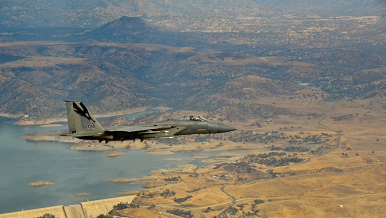 An Air Force F-15 Eagle flies over Millerton Lake north of Fresno, Calif., Nov. 7, 2013. The aircraft is assigned to the 144th Fighter Wing, California Air National Guard. The 144th Fighter Wing recently transitioned their unit's Guard mission from the F-16C Fighting Falcon to the F-15.