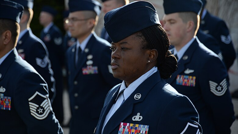 Master Sgt. Shaneeka Jones stands at parade rest during a Veterans Day memorial ceremony Nov. 11, 2013, at the Henri-Chapelle American Cemetery in Belgium. More than 40 American service members participated in the ceremony to honor the service and sacrifice of American veterans. Jones is the superintendent of flight records at the 470th Air Base Squadron at NATO Air Base Geilenkirchen, Germany.