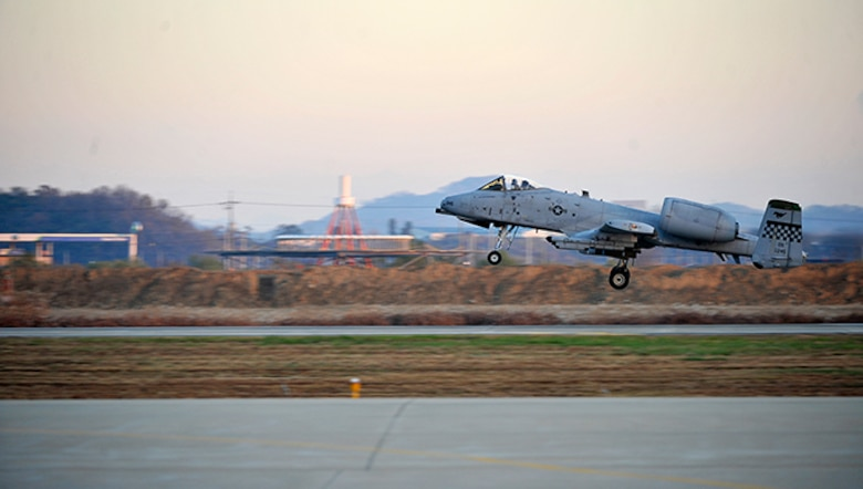 An A-10 Thunderbolt II takes off during the first sortie of Operational Readiness Exercise Beverly Bulldog 14-01 Nov. 18, 2013, at Osan Air Base, South Korea. During the week, Osan AB Airmen will be tested on their ability to utilize their chemical, biological, radiological and nuclear training, as well as administer self-aid and buddy care during contingency operations. The A-10 is assigned to the 25th Fighter Squadron.