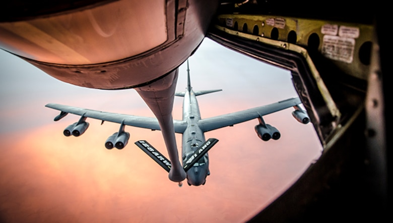Members of a KC-135 Stratotanker crew refuel a B-52 Stratofortress during a training exercise Nov. 3, 2013. The crew is assigned to the 128th Air Refueling Wing, Milwaukee, Wisc. The mission of the 128th ARW is to transfer fuel to U.S. military and allied aircraft, provide aeromedical evacuation, and airlift personnel and equipment to strategic locations in a cost effective manner.
