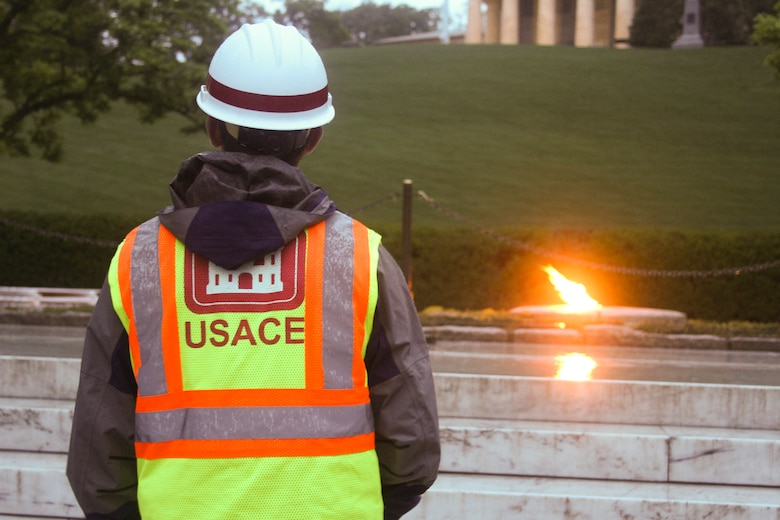 Nicholas Backert, a Norfolk District project engineer, looks at the President John F. Kennedy Eternal Flame at Arlington National Cemetery before contractors instal white fencing to block the public's view of the site April 29, 2013. Repairs and upgrades to the flame include installing burners, an igniter, and new gas and air lines. Contractors estimate that work on the burner itself will take three weeks.