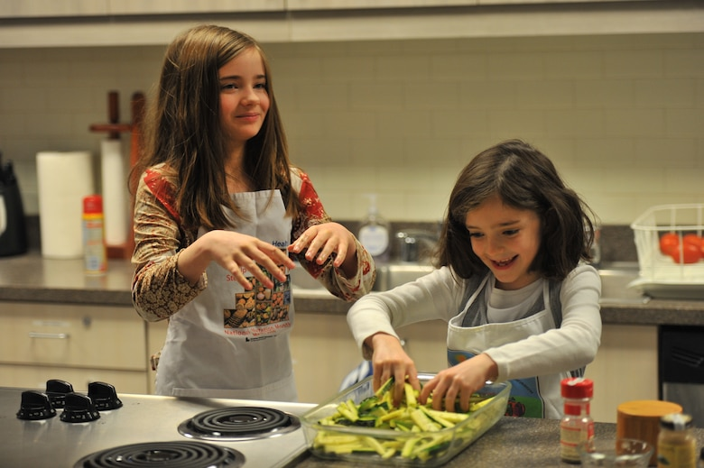 two girls, kitchen, cooking, quarantine cooking