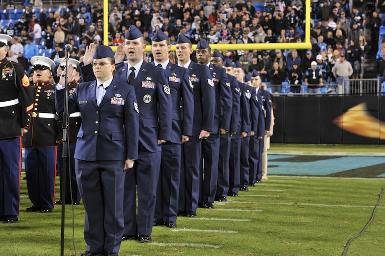 U.S. Air Force Airmen participate in a re-enlistment ceremony before the start of the Carolina Panthers verses New England Patriots game at Bank of America Stadium in Charlotte, N.C.,  Nov. 18, 2013. The game was the Panthers' salute to service game and included a re-enlistment ceremony, a Purple Heart awarding and service members leading the Panthers out of the tunnel. (U.S. Air Force photo by Airman 1st Class Jonathan Bass/Released)