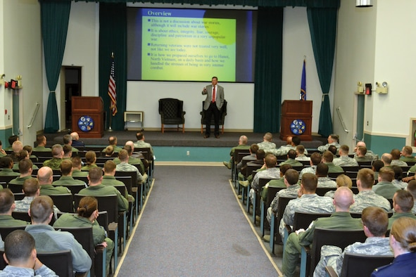 "Retired Col. Chuck DeBellevue addresses members of the 552nd Air Control Wing during a heritage event on Nov. 6 in the 552nd Operations Group Auditorium. Colonel DeBellevue, the highest scoring ace of the Vietnam War and the last American ace on active duty, spoke about the air war in the skies over Hanoi, North Vietnam and ""Taking the Fight to the Enemy"". Colonel DeBellevue flew 220 combat missions as a Laredo High Speed Forward Air Controller and was credited with the destruction of six enemy fighters in aerial combat as a weapons system officer. This is the third heritage event held by the wing. Col. Jay Bickley, 552nd Air Control Wing commander, is using these events to remind his Airmen of their impressive and proud heritage. (Air Force photo by Ron Mullan)"