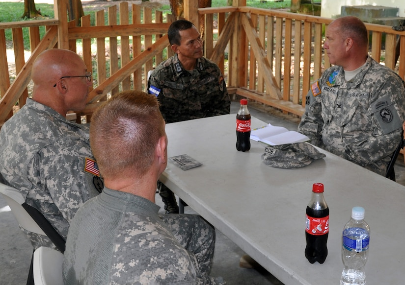 U.S. Army Col. Thomas Boccardi, Joint Task Force-Bravo Commander, U.S. Army Col. John Sena, Army Support Activity Commander, and U.S. Army Lt. Col. E.J. Irvin, 1-228th Aviation Regiment Commander, visit with Honduran Army Lt. Col. Santos Colindres, Deputy Commander of the Honduran 5th Infantry Batallion, at Mocoron, Honduras, Nov. 20, 2013. The military leaders discussed how Joint Task Force-Bravo can continue to assist and work together with the Honduran military, as well as the importance of continuing to build on the strong relationship between the United States and Honduras. (U.S. Air Force photo by Capt. Zach Anderson)