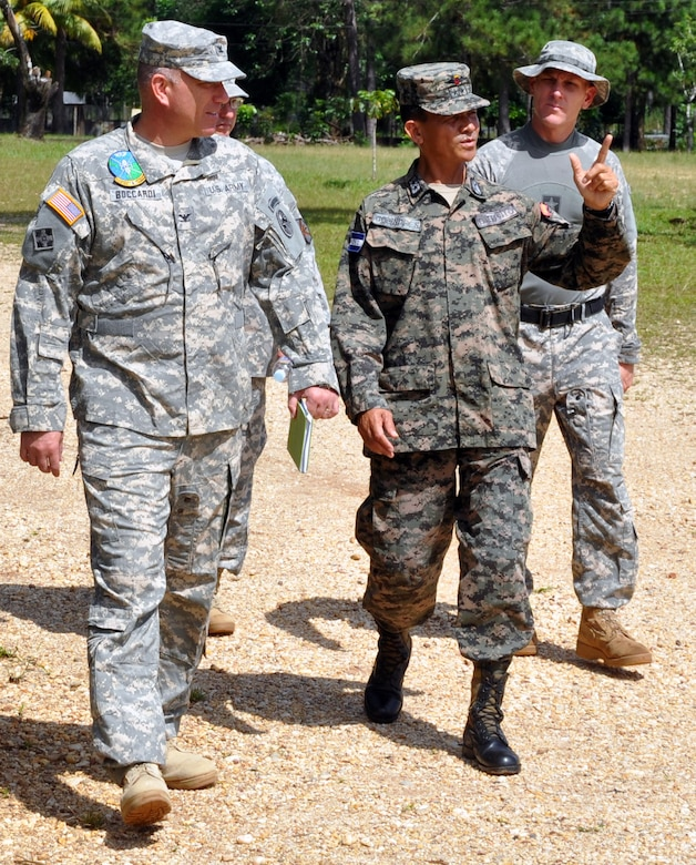 U.S. Army Col. Thomas Boccardi, Joint Task Force-Bravo Commander, visits with Honduran Army Lt. Col. Santos Colindres, Deputy Commander of the Honduran 5th Infantry Batallion, at Mocoron, Honduras, Nov. 20, 2013. Boccardi and Colindres discussed how Joint Task Force-Bravo can continue to assist and work together with the Honduran military, as well as the importance of continuing to build on the strong relationship between the United States and Honduras. (U.S. Air Force photo by Capt. Zach Anderson)