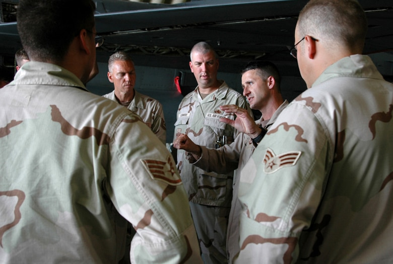 Col. Steven S. Nordhaus, currently the 180th Fighter Wing Commander, Ohio Air National Guard, speaks with deployed 180th Airman during an overseas Air Expeditionary Force rotation.  In this 2005 photo, Nordhaus was the detachment commander for the wing while deployed to Al Udeid, Qatar in 2005. Not only was he instrumental in bringing the wing home after a 60-day rotation with a 100% success rate for mission accomplishment, he also took it upon himself to ensure that every Airman understood their role and importance to the mission.   During the deployment, Nordhaus made it a personal mission to travel around the Air Base to visit with every single 180th Airman to thank them for their hard work and dedication to the mission and foster their understanding that their specific roles while deployed directly contributed to the success of the overall mission. He also used the time with each Airman to seek feedback on what he could do to help the Airmen, both personally and professionally, throughout the deployment. (U.S. Air National Guard Photo by Master Sgt. Beth Holliker / Released).