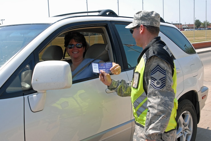 GOODFELLOW AIR FORCE BASE, Texas -- Members receive wingman cards that contain important numbers for organizations such as Airman Against Drunk Driving, local cab services, 17th Security Forces Squadron, Sexual Assault Response Coordinator hotline and more as they leave the base for the holiday. These numbers can also be found on the Goodfellow home page website. (U.S. Air Force photo/ Airman 1st Class Breonna Veal)