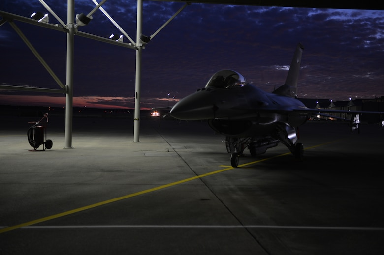 An F-16 Fighting Falcon assigned the 20th Fighter Wing sits parked on the flightline at Shaw Air 