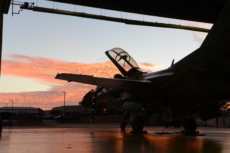 An F-16 Fighting Falcon assigned to the 20th Fighter Wing sits parked under an awning at Shaw Air Force Base, S.C., Nov. 19, 2013. The F-16 was prepared to play an important role, in a recent operational readiness exercise, which demonstrated the ability of the 20th FW to safely and promptly provide air superiority. (U.S. Air Force photo by Tech. Sgt. Frank Miller/Released)