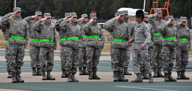 Officer trainees are taught the proper way to salute by Tech. Sgt. Chi Yi, Officer Training School military training instructor, during their first day of drill instruction at OTS. Training instructors teach drill and ceremony to instill discipline, attention to detail and military bearing in the offier trainees.  (U.S. Air Force Photo by Staff Sgt. Gregory Brook)