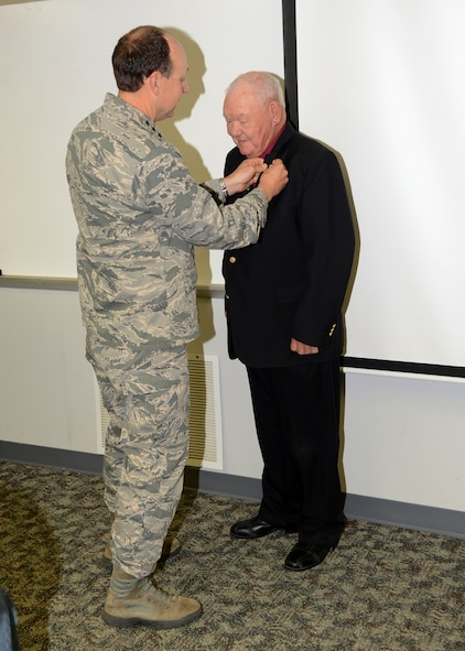 Dr. Troy Corder, an education specialist with the 72nd Force Support Squadron, was awarded his 50-year pin and certificate on Tuesday by Air Force Sustainment Center Commander Lt. Gen. Bruce Litchfield. Dr. Corder has worked as a civil servant at Tinker for 47 years and served three years in the Army. (Air Force photo by Kelly White)