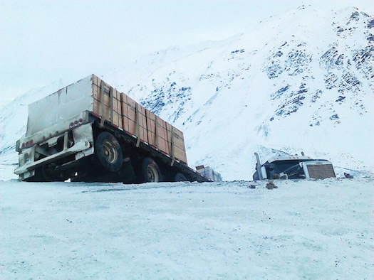 A tractor-trailer jackknifed on the Dalton Highway at Atigun Pass, Alaska, Nov. 2, 2013. In the vehicle behind the truck, two Air Force master sergeants were going hunting. They stopped and extracted the driver, who was perilously close to a 600-foot drop.