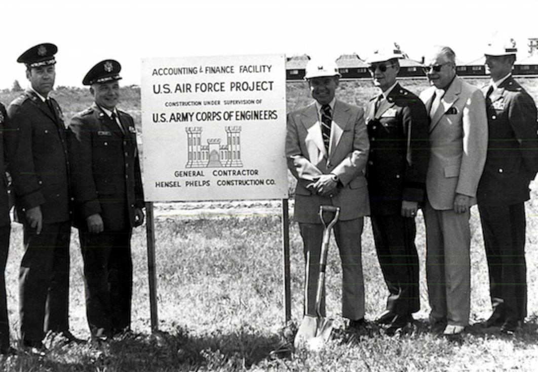 Officials from the Air Reserve Personnel Center, Air Force Accounting and Finance Center, and U.S. Army Corps of Engineers pose for a photo during a groundbreaking ceremony held at the former Lowry Air Force Base, Colo., May 24, 1974. (U.S. Air Force photo)