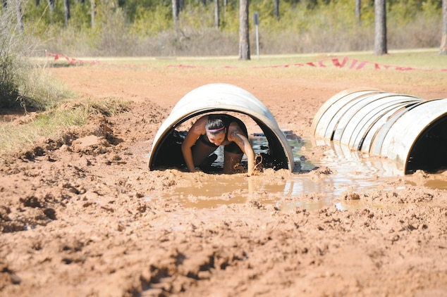 The young and young-at-heart challenge themselves during Marine Corps Logistics Base Albany's second annual Dirty Devil Dog Mud Run, Saturday. Marines, families and citizens from neighborhoods surrounding the base, navigated obstacles, slogged through mud and water during the more than 3-mile course.