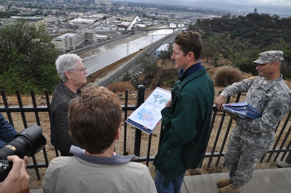 Corps officials brief EPA Administrator Gina McCarthy (left) on Los Angeles County Drainage Area projects during her visit to a Los Angeles River overlook point in Elysian Park Nov. 21. The newly appointed EPA chief visited Los Angeles to get a first-hand view of LA River revitalization efforts.