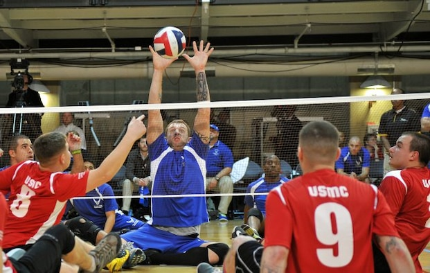 An Air Force wounded warrior goes for the stuff against the Marine Corps wounded warriors at the 3rd Annual Joint Sitting Volleyball Tournament, Nov. 21,2013, at the Pentagon. The Marine Corps beat Air Force in the best of three games and took home the 1st-place trophy.