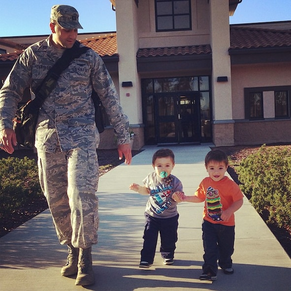VANDENBERG AIR FORCE BASE, Calif. -- Capt. Joseph Picariello, a 533rd Training Squadron flight commander, walks his almost two year-old twin sons, Rocco and Enzo, down a sidewalk in front of the Vandenberg Child Development Center Sept. 27. Rocco and Enzo were born 10 weeks premature and are now healthy young boys. (Courtesy photo)
