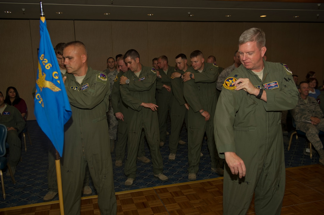 Members of the newly activated 429th Attack Squadron place their patch onto their flight suites to show their pride as a detachment of the 926th Fighter Group out of Nellis Air Force Base, Nev., Nov. 19. The 429th Attack Squadron was initially activated in 1917 and deactivated in 1962.(U.S. Air Force photo by Airman 1st Class Chase Cannon/Released)