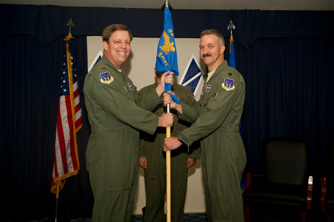 Colonel John Breeden, commander of the 926th Fighter Group at Nellis Air Force Base, Nev., presents the new commander of the 429th Attack Squadron, Lt. Col. Brian Moles, the guidon symbolizing its new attachment to Holloman Air Force Base, N.M., Nov 19. The 429th Attack Squadron was initially activated in 1917 and deactivated in 1962.(U.S. Air Force photo by Airman 1st Class Chase Cannon/Released)