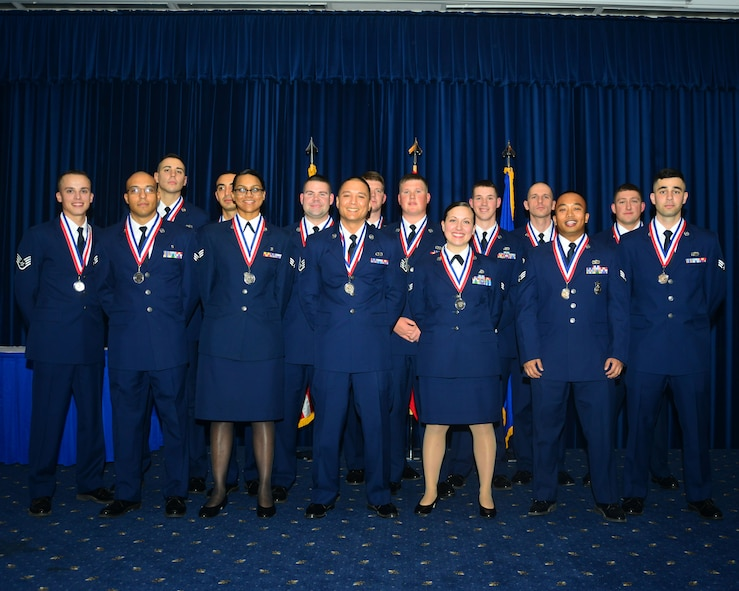 Members of Airman Leadership School Class 14-1 pose for a group photo after completing thier first professtional military education course. ALS is the first PME class Airmen take focusing on the responsibilities of becoming a supervisor. (U.S. Air Force photo by Staff Sgt. Eric Summers Jr.)