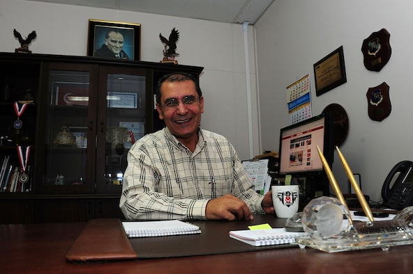 Mehmet Birbiri, 39th Air Base Wing host nation advisor, enjoys a cup of coffee at his desk Nov. 25, 2013, at Incirlik Air Base, Turkey.  Birbiri has worked on Incirlik AB for 39 years.  (U.S. Air Force photo by Airman 1st Class Nicole Sikorski/Released)