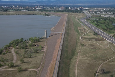 Cherry Creek Dam, completed around 1950, was built and is operated by the U.S. Army Corps of Engineers for the primary purpose of flood risk mitigation. Cherry Creek Dam is an earth-fill embankment dam with an outlet structure for operational water releases. The embankment is 14,300 feet long with a maximum height of 141 feet. The dam's outlet structure is a triple barrel concrete conduit system through which water discharges into the Cherry Creek channel located a short distance downstream.