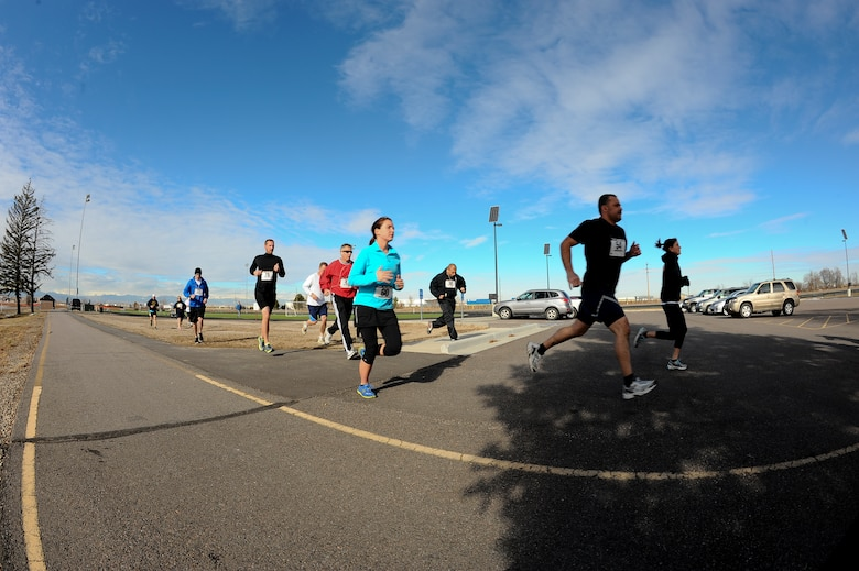 Members of Team Buckley begin the 9th Annual Turkey Trot 5K race Nov. 26, 2013, at the all-purpose field on Buckley Air Force Base, Colo. The fastest runners in each category were given turkeys as prizes. (U.S. Air Force photo by Senior Airman Phillip Houk/Released)