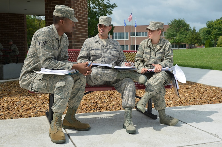 MCGHEE TYSON AIR NATIONAL GUARD BASE, Tenn. - From left, Senior Airmen Ethan W. Richardson, Charles W. Dunkelberger and Maria A. Puetz, attend Airman Leadership School Class 13-6, and participate in group interpersonal communications at the Paul H. Lankford Enlisted Professional Military Education Center at the I.G. Brown Training and Education Center here, July 23, 2013. (U.S. Air National Guard photo by Master Sgt. Kurt Skoglund/Released)