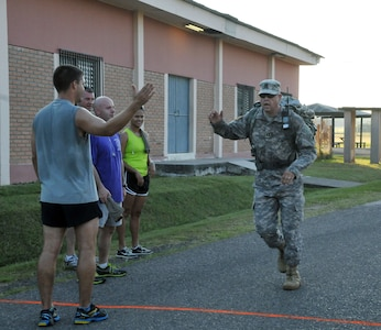 """Members of Joint Task Force-Bravo participate in the """"2013 MWR Turkey Trot 5K Fun Run & Walk"""" to kick off the Thanksgiving Day celebrations at Soto Cano Air Base, Honduras, Nov. 26, 2013. (Photo by Ana Fonseca)"""