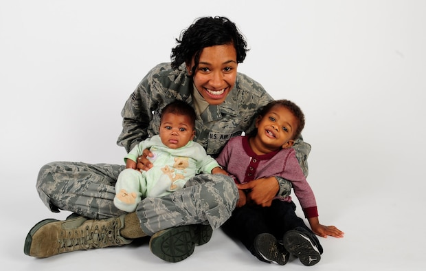 Senior Airman Jenay Randolph, 6th Air Mobility Wing Public Affairs photojournalist, poses for a picture with her children Nov. 25, 2013 at MacDill Air Force Base, Fla. Randolph is the mother of two under the age of two that finds the balance between single motherhood and active-duty Air Force.The son, Jaylen Brown, is 17 months and the daughter, Jordyn, is four months.(U.S. Air Force photo by Senior Airman Shandresha Mitchell/Released)