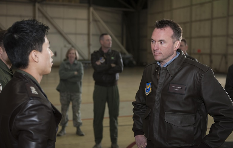 Acting Secretary of the Air Force Eric K. Fanning listens to a Republic of Korea air force Airman Nov. 26, 2013, as he explains the U.S. and ROK partnership at Kunsan Air Base, South Korea. The secretary visited the Wolf Pack to get a better look at Kunsan AB's mission of defending the base, accepting follow-on forces and taking the fight North.